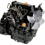 Silnik produkcji Komatsu, koloru czarnego ze srebrnym wentylatorem