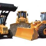 Trzy maszyny budowlane marki Deutz koloru żółtego. Dokładniej mówiąc trzy koparki